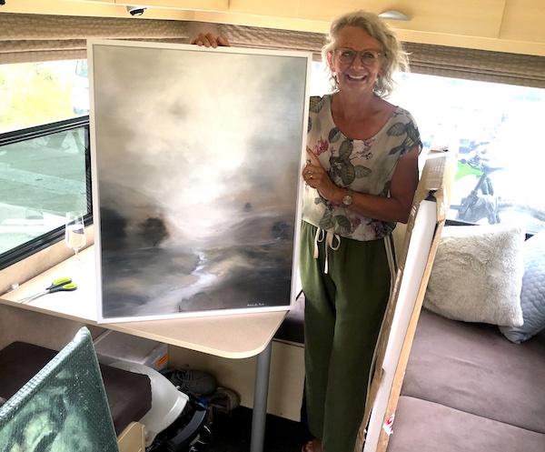 Artist Antoinette Beck with her art in a camper van while exploring Queenstown, New Zealand