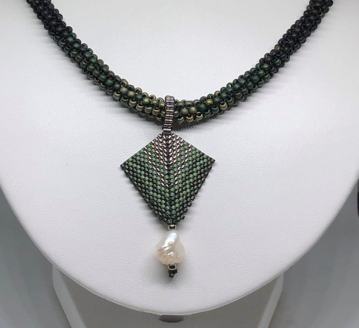Moth shaped bead pendant